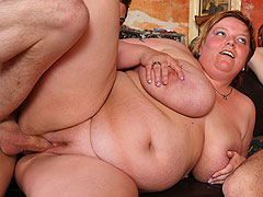 Fat girl rides cock in the bar orgy